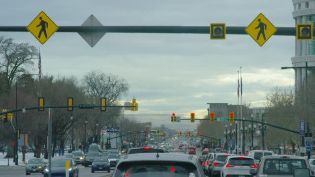 Stopping at a Red Light in Traffic in Downtown Park City, Utah on an Overcast Day