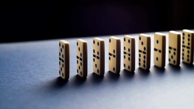 Stopping the domino effect concept for business solution, strategy and successful intervention video