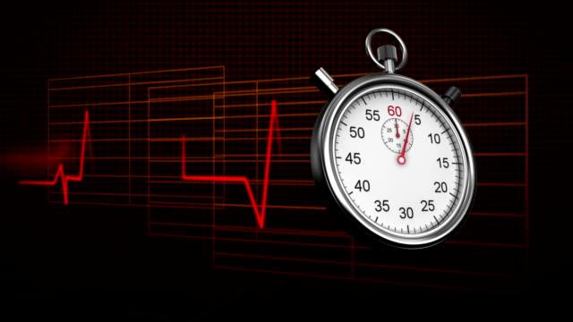 vídeos de stock e filmes b-roll de stopwatch and heart rate - coração fraco