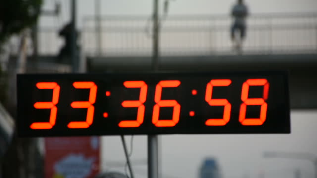 Stopwatch or digital timer for timer runner running in event marathon race run NONTHABURI, THAILAND - APRIL 22 : Stopwatch or digital timer for timer runner running in charity event and marathon race run at Nonthaburi city on April 22, 2018 in Nonthaburi, Thailand instrument of time stock videos & royalty-free footage
