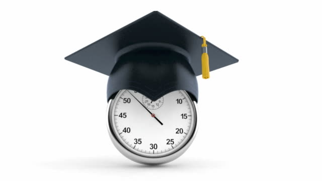 stopwatch with mortarboard - tocco accademico video stock e b–roll