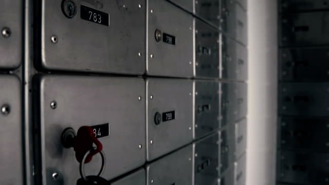 Storage with safe lockers. Taking a key from keyhole video