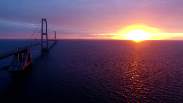 Storebaelt bridge over sea at sunset video