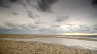istock Storm clouds moving in over the Wadden sandflats in the Dutch Waddensea region in the North of The Netherlands. 1045887210