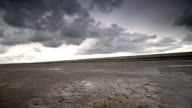 istock Storm clouds moving in over the Wadden sandflats in the Dutch Waddensea region in the North of The Netherlands. 1045895210