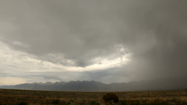 Storm over Crestone, CO and mountain range - 4k time lapse video