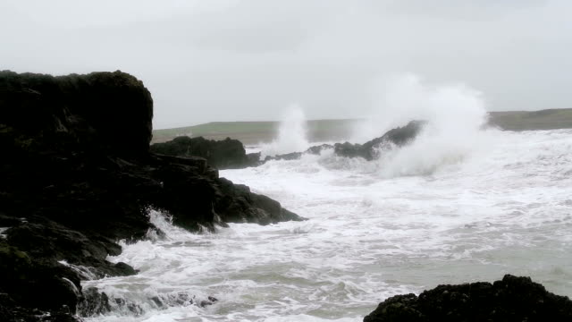 Storm Waves Crashing On Large Rocks As The Waves Hit Shore video
