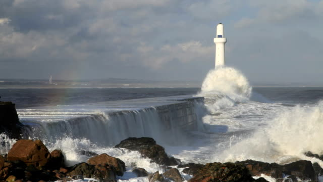 Storm waves striking the breakwater, Aberdeen, Scotland North Sea waves breaking against the wall at the entrance to Aberdeen Harbour, Scotland. scotland stock videos & royalty-free footage