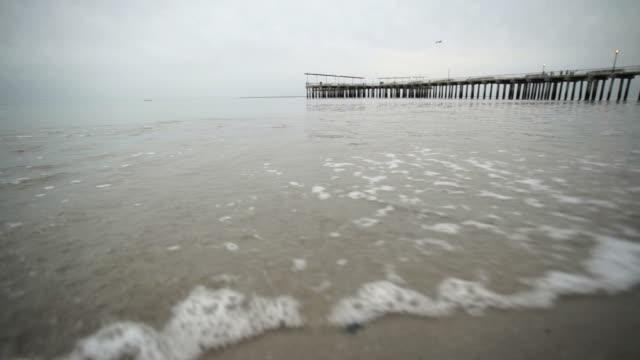 vídeos y material grabado en eventos de stock de vehemente beach - letra s