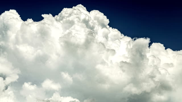 stormy movement of three-dimensional white clouds, like a background on a blue sky video