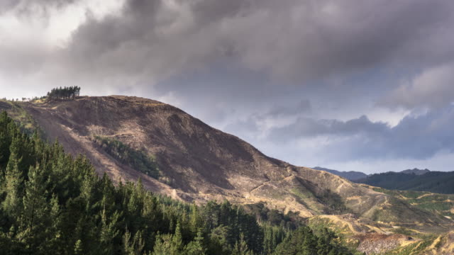 Stormy Sky Over Deforested Hillside - Time Lapse video