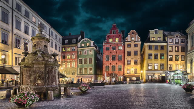Stortorget square with colorful houses in Stockholm, Sweden Stortorget square with colorful houses in the center of Old Town of Stockholm, Sweden at dusk (static image with animated sky) stockholm stock videos & royalty-free footage
