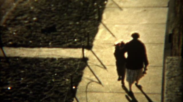 1955: Storytelling of mom teaching child to rollerskate one step at a time and returning home. video