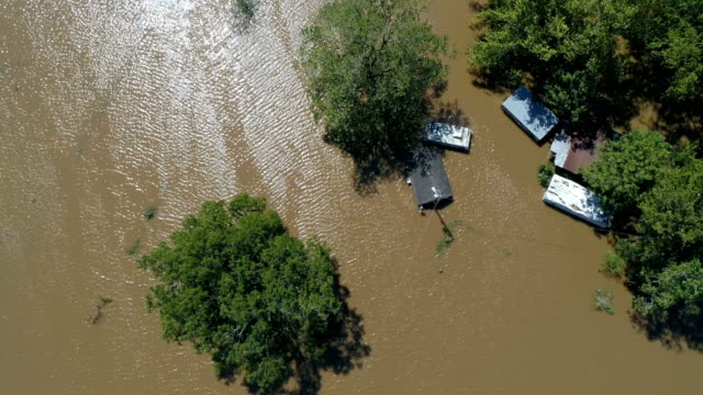 Straight down above massive flood with Homes and barn and buildings under water in Columbus , Texas Small Town Gulf Coast Damage zone from Hurricane Harvey Path of Destruction.