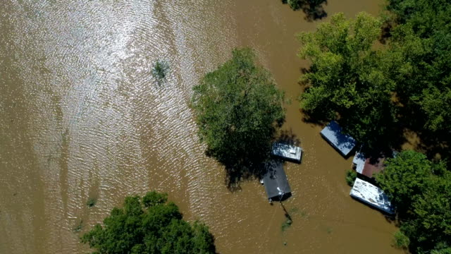straight down drone view above flooded homes almost completely under water columubus  , texas small town gulf coast damage zone from hurricane harvey path of destruction. - uragano video stock e b–roll