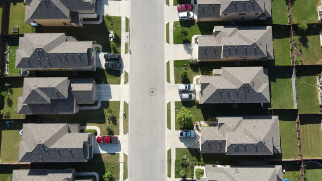 Straight down in the middle of Two sides of the Neighborhood Aerial drone views Straight down in the middle of Two sides of the Neighborhood home ownership stock videos & royalty-free footage