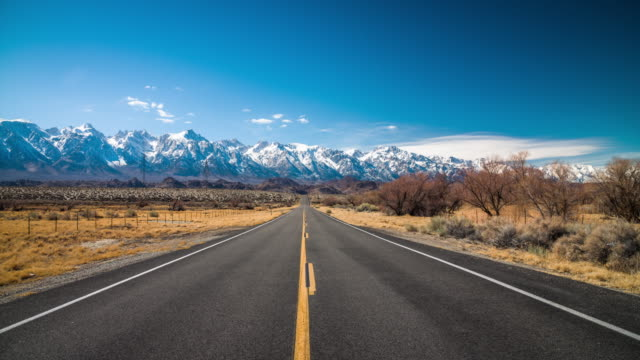 Straight endless road to the mountains