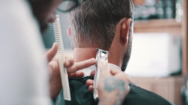 Straight lines from skilled hands 4k video footage of a man getting a haircut at a barbershop small business saturday stock videos & royalty-free footage