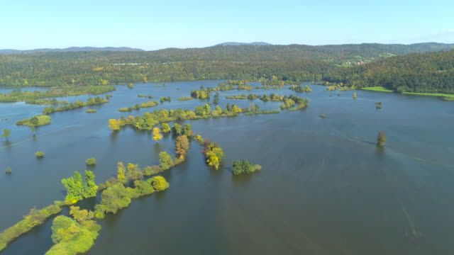 AERIAL: Stranded trees and submerged countryside fields after heavy autumn rain. video