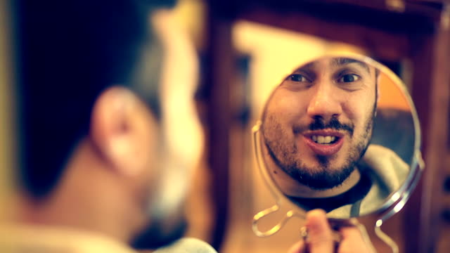 strange man makes faces on a mirror: teeth, eyes, mad, madness, loneliness video