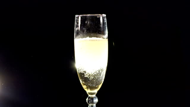 Strawberry falling into a glass of champagne. video