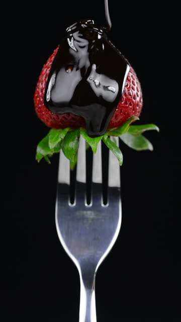 strawberry in chocolate - vertical format video stock videos and b-roll footage