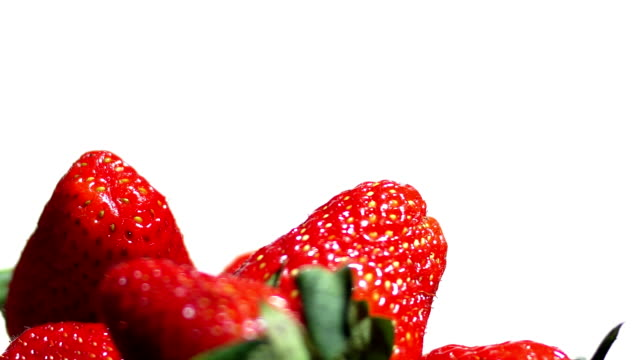 Strawberry on white background spinning video