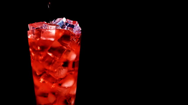 Strawberry soda pouring into glass of ice at slow motion on a black background Pouring red soda into  a glass of ice at slow motion on a black background cherry stock videos & royalty-free footage