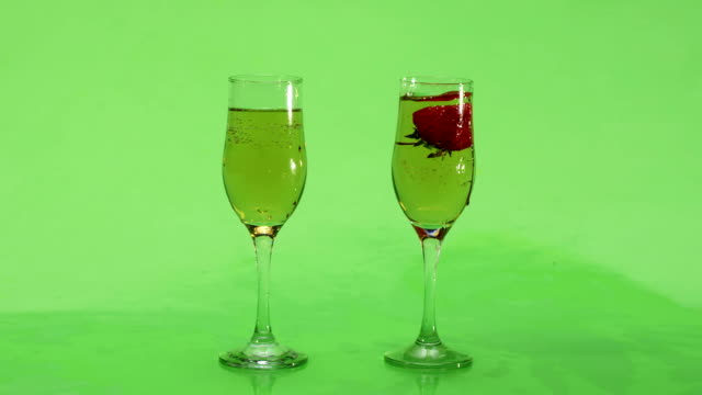 Strawberry splash in a champagne flute. Slow motion. Green screen. video