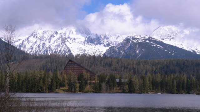 Strbske Pleso, Mountain Lake in the Clouds and Snowy Mountains on Background. Slovakia