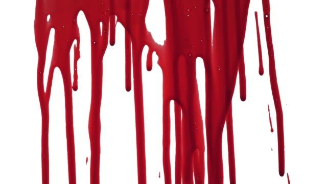 streaks of blood pouring on a white surface - kropla filmów i materiałów b-roll
