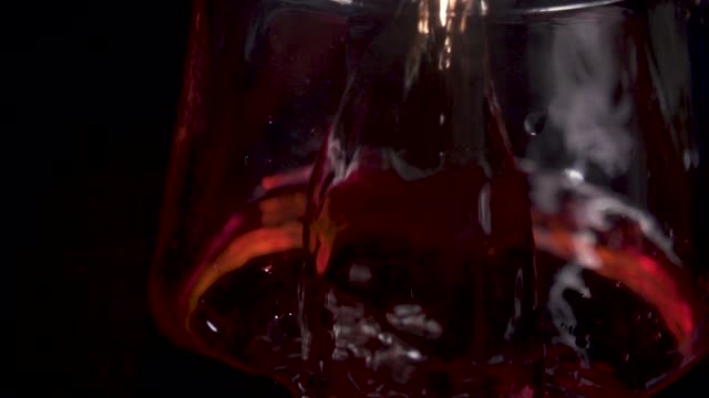 stream of wine is poured onto the decanter glass and bubbles - decanter video stock e b–roll