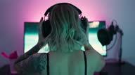 istock Streamer putting her headphone on before gaming 1296587603