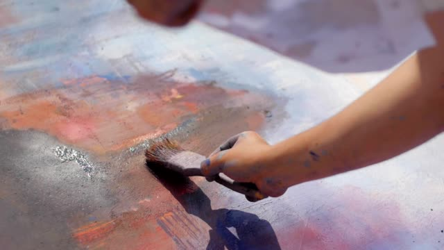Street artists and painters at work Slow motion of writer hand painting on the wall with brush mural stock videos & royalty-free footage