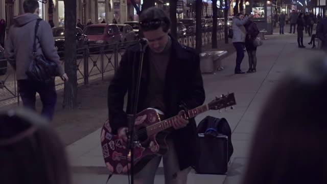 Street guitarist playing at night video