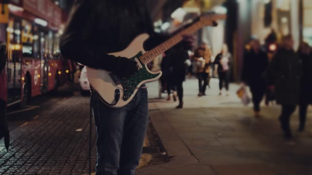 street guitarist playing at night - musician stock videos and b-roll footage