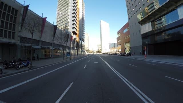 street in a modern district in barcelona, spain - проспект стоковые видео и кадры b-roll