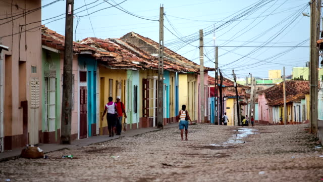 Street in Trinidad, Cuba Street scene Trinidad, Cuba. Cobble stone street and traditional colourful houses. developing countries stock videos & royalty-free footage