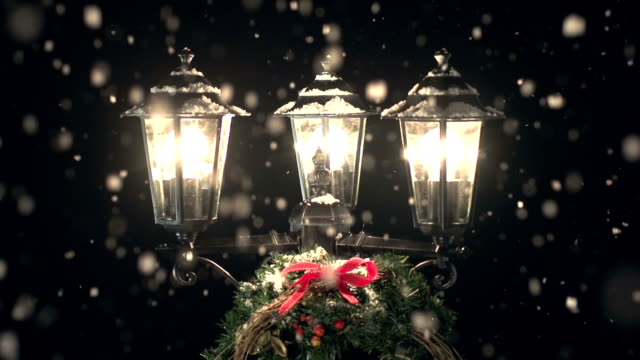 Street Lamp post in the Snow with Christmas Wreath video