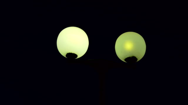 Street light on lamppost at night video