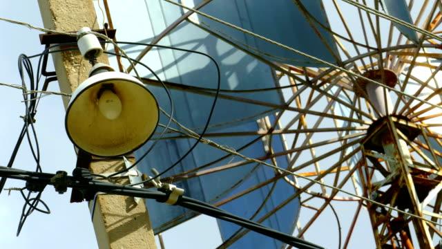 street lighting against a wind generator