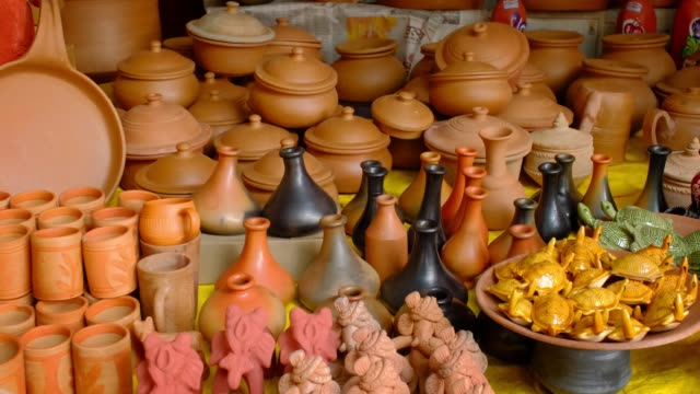 Street market exhibition of handmade pots, jars, ceramic products, souvenirs. Udaipur, Rajasthan, India