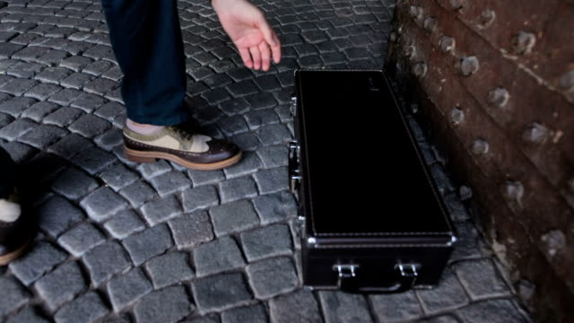 Street musician opens a suitcase video