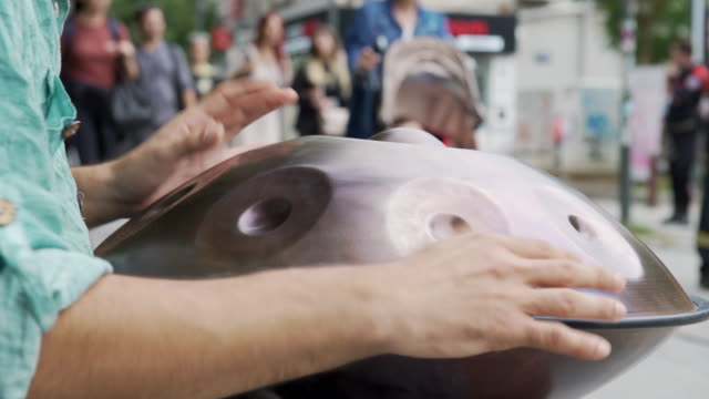 Street musician playing handpan (sound/audio available)