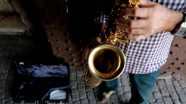 Street musician playing the saxophone video