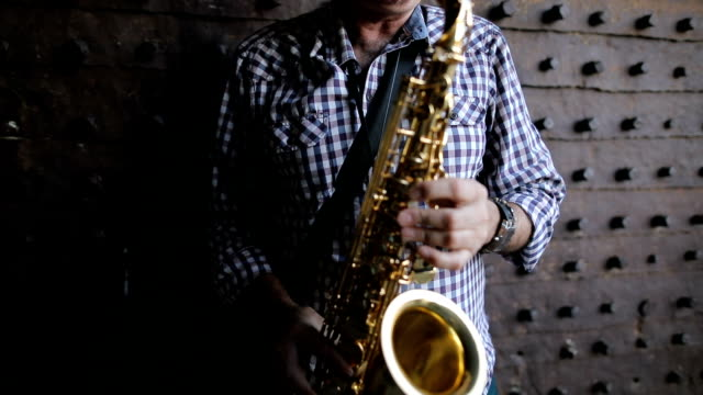 Street musician playing the saxophone