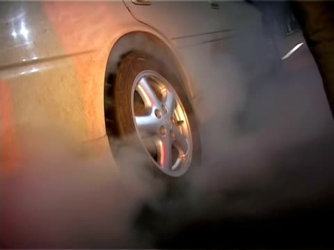 Street racing. Car burning tires.  Auto sport video