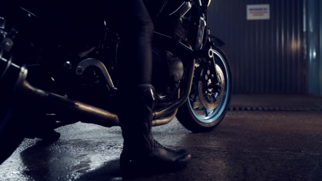 Street sports bike stands in a modern stylish garage. Street sports bike stands in a modern stylish garage. Reflection of light on black metal parts of a motorcycle. Motorcycle advertising. Motorcycle repair services. Need for Speed. motorcycle stock videos & royalty-free footage