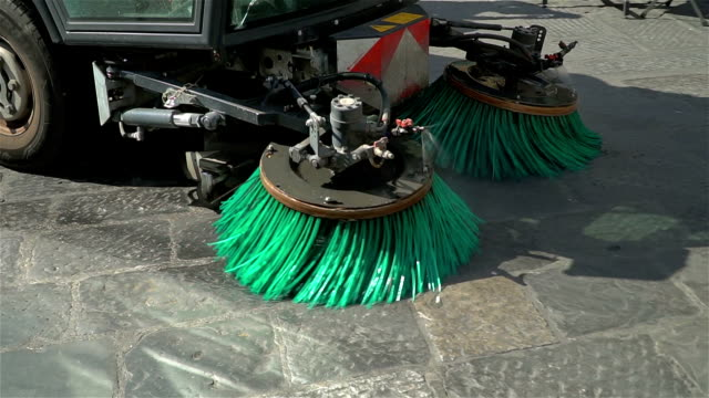 street sweeper cleans the stone, historic street in the center of the tourist city. - igiene video stock e b–roll