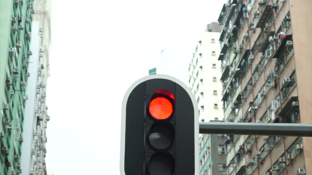 Street traffic red light with urban tall building background video